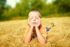 Free Young Boy Laying On Ground Stock Photo - 15583380