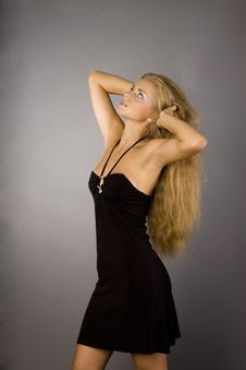 Free Blonde Girl In A Black Dress Stock Images - 15583434
