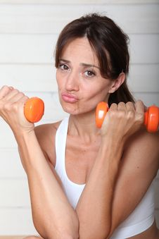 Free Woman Holding Weights Stock Images - 15586514