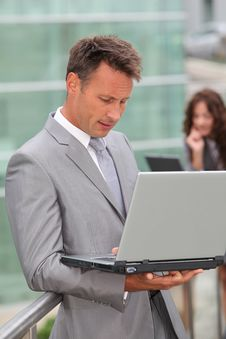 Free Businessman Working On Laptop Computer Royalty Free Stock Image - 15586636