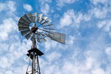 Old Metal Windmill Against Cloudy Sky Stock Photography
