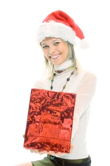 Beauty Blonde Girl In Santa Cap With Christmas Gift Stock Image