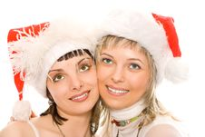 Couple Brunette And Blonde Girl In Santa Caps Royalty Free Stock Image