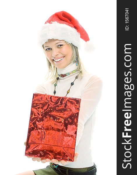 Beauty blonde girl in santa cap with christmas gift