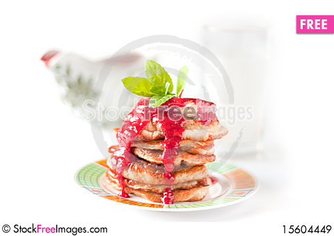 Free Pancakes With Rasberry Sauce. Sauceboat And Milk Royalty Free Stock Images - 15604449
