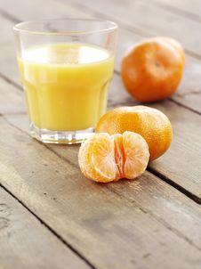 Mandarin And Glass Of Juice Stock Image