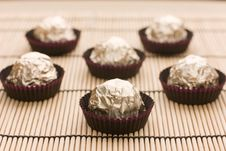 Free Choco  Candies In Golden Foil On Table Royalty Free Stock Photography - 15604017