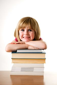 Free Young Girl Leaning On A Stack Of Books And Smiling Royalty Free Stock Photography - 15606297