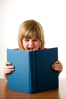 Free Young Girl Shouting Over Book Royalty Free Stock Image - 15606406