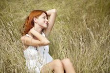 Beautiful Red-haired Girl At Grass Royalty Free Stock Images