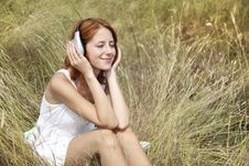 Free Beautiful Red-haired Girl At Grass With Headphones Royalty Free Stock Photography - 15608117