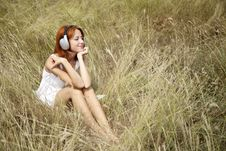 Free Beautiful Red-haired Girl At Grass With Headphones Royalty Free Stock Photo - 15608145