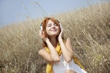 Beautiful Red-haired Girl At Grass With Headphones Stock Photography