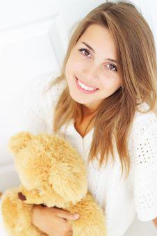 Free Girl Hugs Teddy Bear Royalty Free Stock Photography - 15608437
