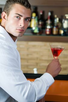 Free Man In A Pub With Red Martini Waiting Stock Photography - 15608982