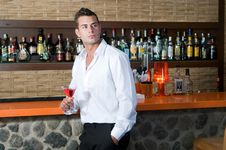 Free Man In A Pub With Martini Waiting Royalty Free Stock Photo - 15609135