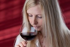 Free Women Smelling Red Wine. Royalty Free Stock Image - 15609716