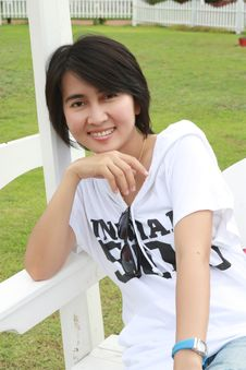 Free Thai Woman Sitting On A Bench Stock Images - 15613184