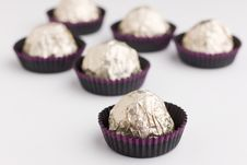 Free Choco  Candies In Golden Foil On Table Stock Images - 15614344