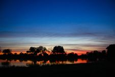 Free Blue And Red Sunset Over River With Hippos Royalty Free Stock Photo - 15620025