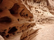 Intersting Holes In Canyon Wall Royalty Free Stock Photo