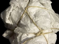 Free Untidy Parcel Of Tissue Paper Tied With String Royalty Free Stock Photos - 15621528