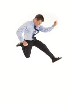 Young Businessman Jumping In The Air Royalty Free Stock Photography