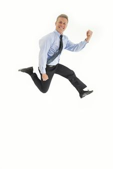 Young Businessman Jumping In The Air Stock Photo