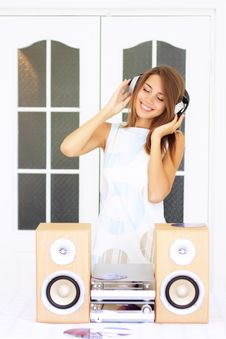 Girl Listens To Music In Headphones Royalty Free Stock Photos