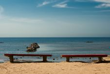 Free Two Empty Benches On The Beach. Stock Image - 15625191