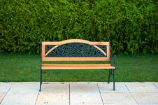 Free Nice Bench In Front Of Green Grass And Bushes Royalty Free Stock Photography - 15625587