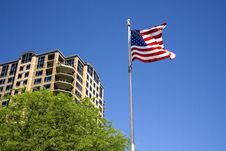 Free US Flag By A Building. Stock Image - 15628041