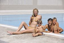 Happy Young Family Have Fun On Swimming Pool Stock Photo