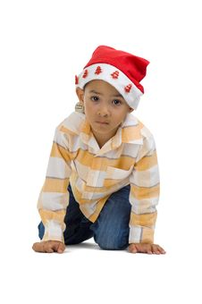 Boy With Santa Claus Hat Royalty Free Stock Photography