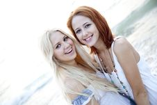 Free Two Beautiful Young Girlfriends On The Beach Royalty Free Stock Photos - 15639458