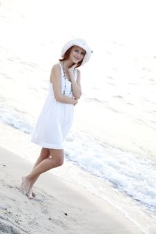 Beautiful Red-haired Girl In Hat On The Beach Stock Photo