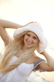 Free Beautiful Young Blonde Girl In Hat On The Beach Royalty Free Stock Photos - 15639678