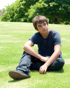 Free Young Boy Sitting On Grass Royalty Free Stock Photo - 15639895