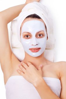 Young Woman With Cosmetic Mask Stock Photo
