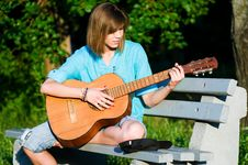 Free Teenage Girl With Guitar Royalty Free Stock Photography - 15646337