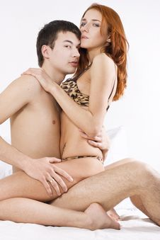 Young Couple Embracing In Bedroom Royalty Free Stock Photography