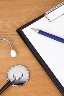 Stethoscope And Paper On Table Royalty Free Stock Photo