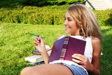 Free Young And Beautiful Girl Doing Home Work Stock Images - 15649344