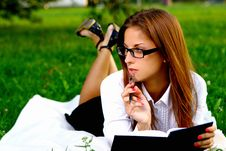 Free Young And Beautiful Girl Doing Home Work Stock Images - 15649354