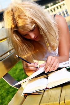 Free Young And Beautiful Girl Doing Home Work Royalty Free Stock Photography - 15649357