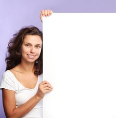 Free Girl Holding The Edge Of A White Billboard Stock Images - 15655534