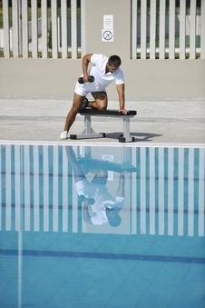 Free Young Man Exercise At Poolside Stock Photo - 15658760