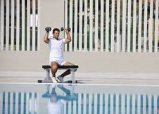 Free Young Man Exercise At Poolside Stock Image - 15659021