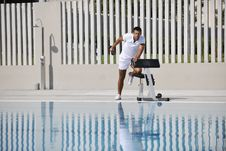 Free Young Man Exercise At Poolside Stock Photos - 15659553