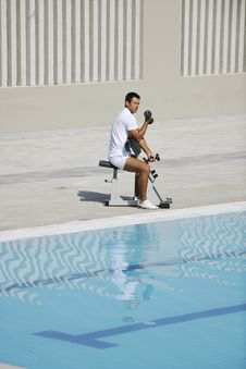 Free Young Man Exercise At Poolside Stock Photography - 15659642